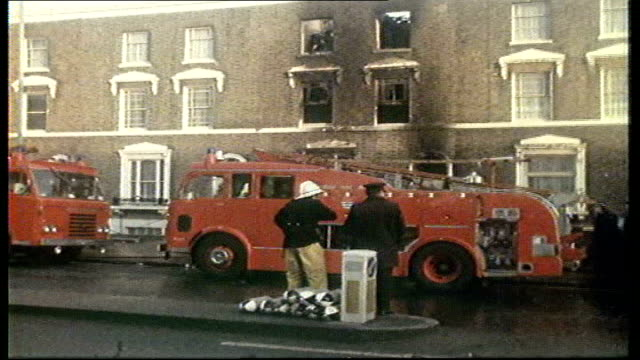 25th anniversary of new cross fire; tx 18.1.1980 new cross: ext fire engines outside burnt out house where birthday was being held smoke filled... - soot stock videos & royalty-free footage