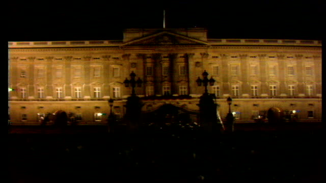 25th anniversary of the coronation celebrations england london buckingham palace gv crowds outside buckingham palace dissolve ms queen's guard stands... - buckingham palace stock-videos und b-roll-filmmaterial