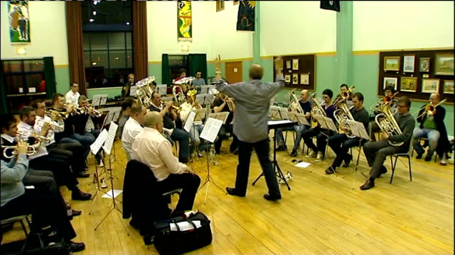 vídeos y material grabado en eventos de stock de 25th anniversary of the start of the 1984 miners' strike: report from grimethorpe; int various of grimethorpe colliery band playing sot **music... - bare tree