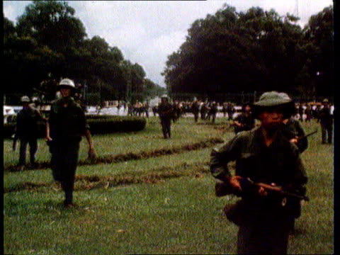 25th anniversary VIETNAM WAR 25th anniversary LIB 1975 GV Vietcong tank towards into presidential compound at fall of Saigon MS Vietcong troops...