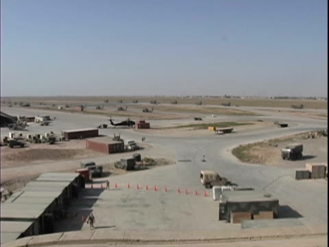 25th dec 2003 montage overview of flight line hangars and living area at lsa anaconda / lsa anaconda iraq / audio - 2003 bildbanksvideor och videomaterial från bakom kulisserna
