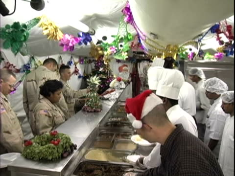 25th dec 2003 montage soldiers preparing and eating christmas dinner in us military camp, arifjan kuwait / iraq / audio - male likeness stock videos & royalty-free footage