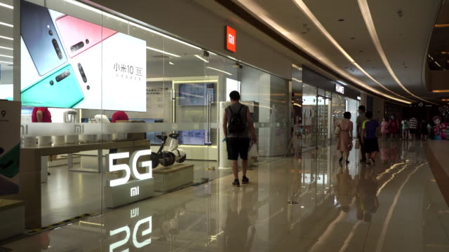 a mi shop in a shopping mall xiaomi is the leading 5g communication and ai company in china - 5g stock videos & royalty-free footage