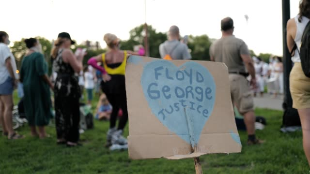 25th july 2020: painted signs at the 56th night of the george floyd vigil at mccarren park included live afro-brazilian percussive music by mambembe,... - memorial vigil stock videos & royalty-free footage