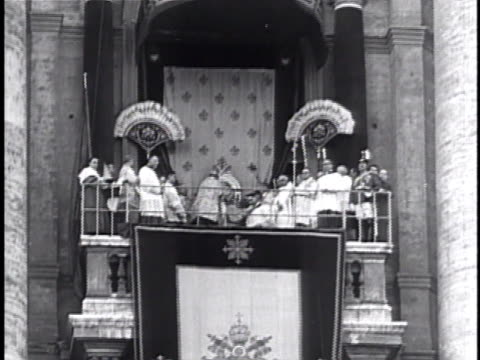 260th bishop of rome: coronation: huge crowd in st. peter's square. pope pius xii on loggia w/ others, male placing papal tiara. crowd, catholics... - tiara stock videos & royalty-free footage