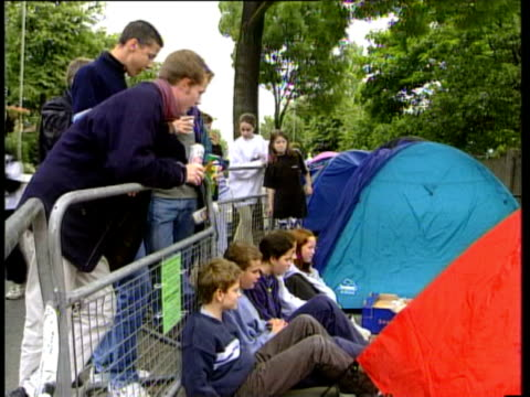 stockvideo's en b-roll-footage met 26jun1998 montage people watching tv as england play colombia including glastonbury festival goers and tony blair empty roads pub celebrations /... - 1998