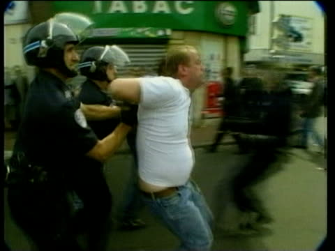 26jun1998 montage world cup minor scuffles and arrests colombian fans with english fans prince charles and prince harry arrival / audio - aggression stock videos & royalty-free footage