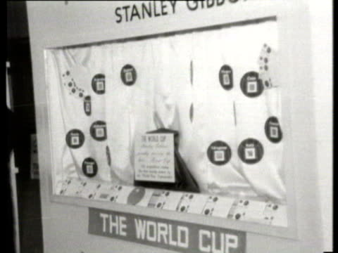 26mar1966 b/w montage world cup stolen police officer stood by empty cabinet where world cup had been displayed / united kingdom - 1966 stock-videos und b-roll-filmmaterial