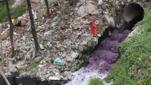 26th june 2020: waste water containing fabric dye is released into streams and rivers by textile industries in savar, bangladesh. this dyed... - dye stock videos & royalty-free footage