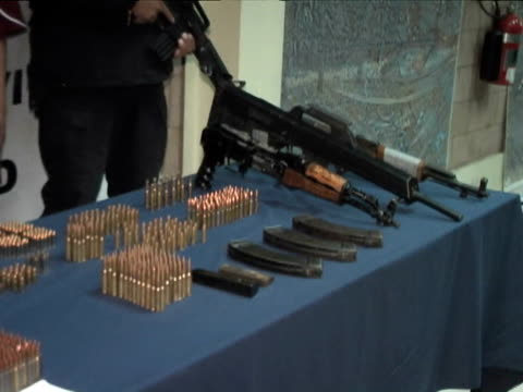 27Feb2010 MONTAGE Presentations by Mexican military antinarcotics operations of alleged drug cartel members with their drug weapons caches / Ciudad...