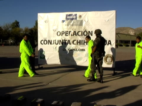 27feb2010 montage presentations by mexican military antinarcotics operations of alleged drug cartel members with their drug weapons caches / ciudad... - drug cartel stock videos and b-roll footage
