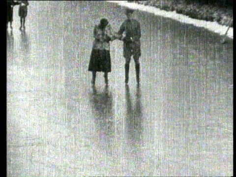 vídeos de stock, filmes e b-roll de jan-1933 b/w montage queen wilhelmina and princess juliana skating on the ice / the hague, zuid-holland, netherlands - 1933