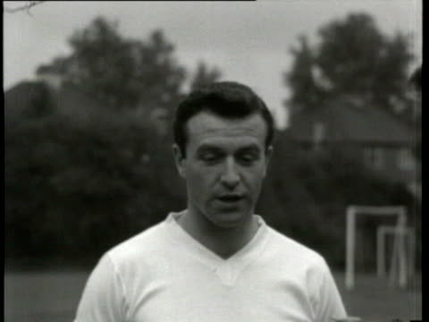 jun-1961 b/w montage jimmy armfield, england captain interviewed by jimmy hill on england's prospects in world cup, team training / united kingdom /... - ゴールポスト点の映像素材/bロール
