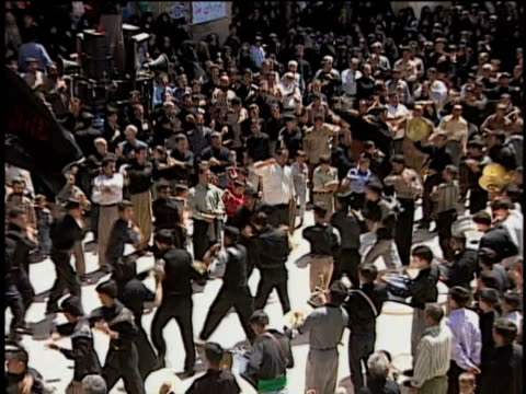 27th april 2000 cu zo ws ha religious procession of mourners during anniversary of martyrdom of imam husayn, ashura ceremony / qum, iran - arm stock videos & royalty-free footage