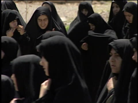 27th april 2000 cu women in black veils during religious procession of mourners, anniversary of martyrdom of imam husayn, ashura ceremony / qum, iran - baby girls stock videos & royalty-free footage