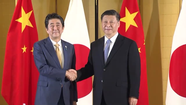 27th june 2019 location osaka city shot list japanese prime minister shinzo abe and chinese president xi jinping shaking hands /abe and xi meeting... - presidente video stock e b–roll