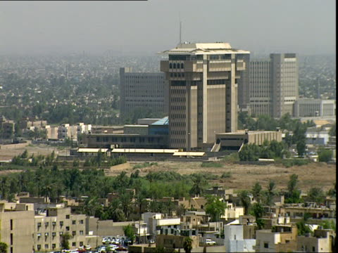 aug-1999 downtown baghdad in smog seen from roof of sheraton ishtar hotel / iraq - personal land vehicle stock videos & royalty-free footage
