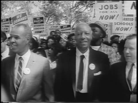 28th august 1963 roy wilkins and a philip randolph marching with crowd / march on washington / newsreel - 1963 march on washington stock videos and b-roll footage