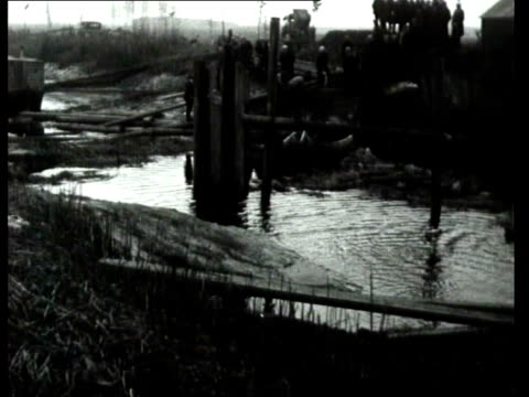 2Feb1931 B/W MONTAGE Effects of a dike burst and repair work on the dike / Netherlands