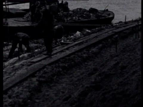 2jul1924 b/w montage construction work for the benefit of the zuider zee works in wieringen / wieringen noordholland netherlands - 1924 stock videos & royalty-free footage
