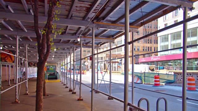 2nd avenue. new york. typical scene of pedestrian, renew, and building - fönsterrad bildbanksvideor och videomaterial från bakom kulisserna