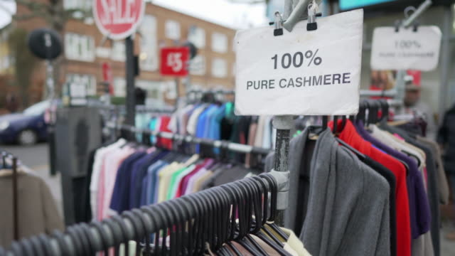 2nd hand cashmere clothes for sale in portobello road - market stall stock videos & royalty-free footage