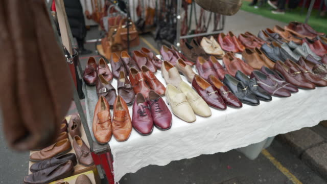 2nd hand retro shoes for sale on a market stall in portobello road, london - notting hill videos stock videos & royalty-free footage