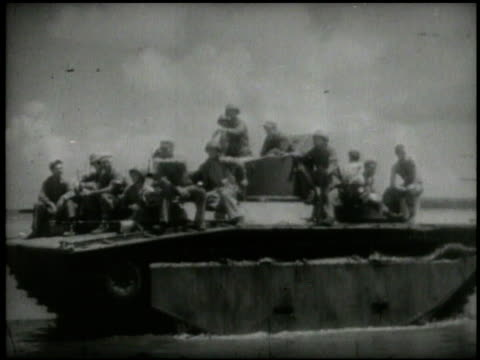 vídeos y material grabado en eventos de stock de s 2nd marine division soldiers in landing crafts approaching tinian island amphibious tanks crafts jeep landing on beach tanks soldiers advancing... - tinian