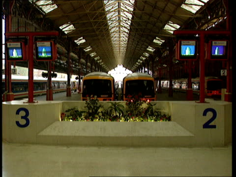 ENGLAND LondonKings Cross Station GV Station with empty tracks PULL OUT Gv Empty tracks Victoria Station GV Empty station concourse PULL OUT from...