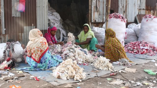 workers sorting through garment leftovers at a jhoot godown in savar near dhaka recycling of waste raw materials left by garment factories has... - textile industry stock videos & royalty-free footage