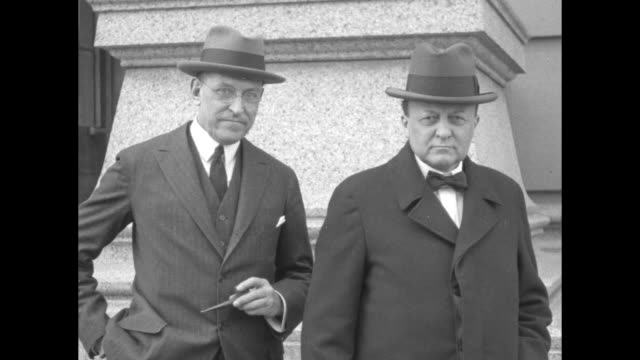 shot attorney owen roberts, at left holding pipe, and former oh senator atlee pomerene, special prosecutors appointed by pres. calvin coolidge to... - 不祥事点の映像素材/bロール