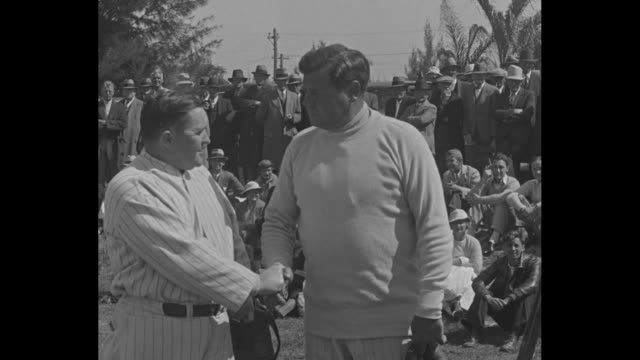 2shot New York Yankees manager Joe McCarthy and player Babe Ruth stand at spring training session in St Petersburg FL / the two shake hands SOT...