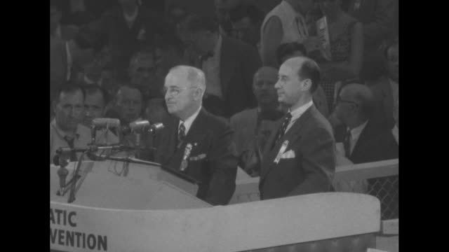 vidéos et rushes de 2shot president harry truman and adlai stevenson at podium during democratic national convention at chicago's international amphitheatre truman bangs... - adlai stevenson