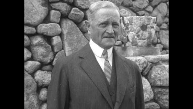 2shot us pres calvin coolidge and retired us gen john j pershing stand in front of rock wall during pershing's visit to coolidge's south dakota... - south dakota stock-videos und b-roll-filmmaterial