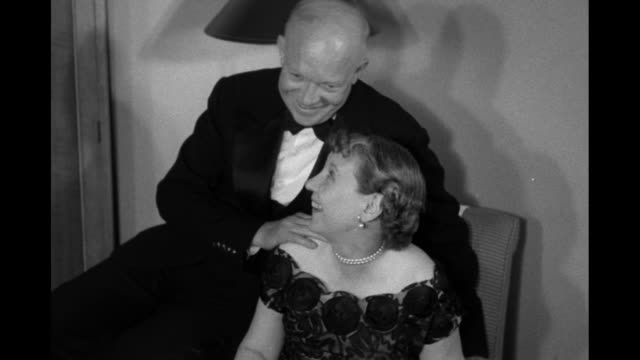 VS 2shots smiling Dwight and Mamie Eisenhower on election night Eisenhower wears a tuxedo Mamie wears pearl earrings and necklace
