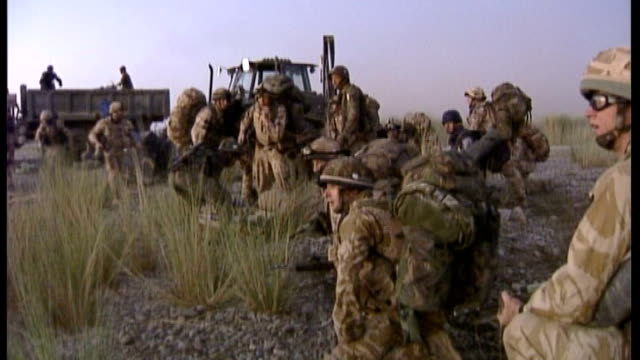 300th british soldier dies in afghanistan file september 2006 / r21090601 helmand province british troops firing weapons in desert area during gun... - military helicopter stock videos & royalty-free footage