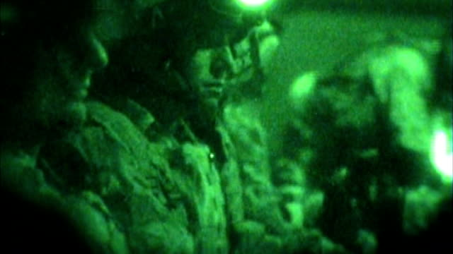300th british soldier dies in afghanistan file september 2006 / r21090601 helmand province vision shots of british soldier in chinook helicopter as... - night vision stock videos and b-roll footage