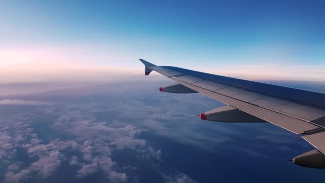 4K 30fps of Aeroplane Wing View Window Late Evening at 40000ft cruising 3840x2160