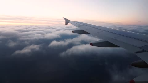 4k 30fps of aeroplane wing view window late evening at 40000ft cruising 3840x2160 - float stock videos & royalty-free footage