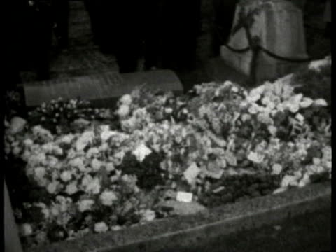 30Jan1965 B/W MONTAGE Excerpts from the State Funeral of Sir Winston Churchill Royal party watch crowds gathered at Bladon church wreaths on grave...
