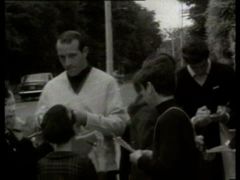 30jul1966 b/w montage bobby charlton arrival fans touts / london united kingdom - toothy smile stock videos & royalty-free footage