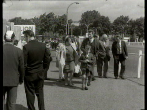 30jul1966 b/w montage england world cup win people on sidewalk supporters carrying german and british flags / london united kingdom / audio - 1966 stock-videos und b-roll-filmmaterial