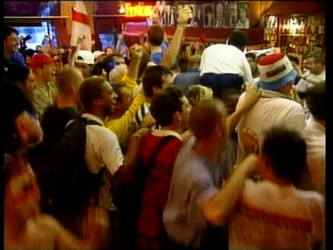 jun-1998 montage england beaten by argentina: fans watching in st. etienne bar; argentine fans; both fans together; misery at end / united kingdom /... - 1998 stock-videos und b-roll-filmmaterial