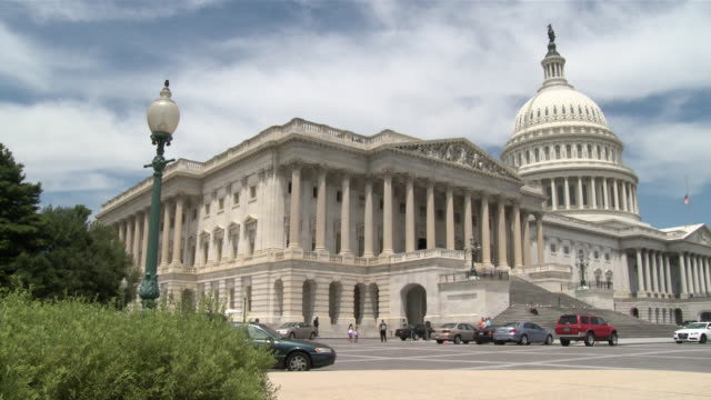 30jun2010 ws pan exterior of us capitol building from 'house triangle' paved area / washington dc united states / audio - building feature stock videos & royalty-free footage