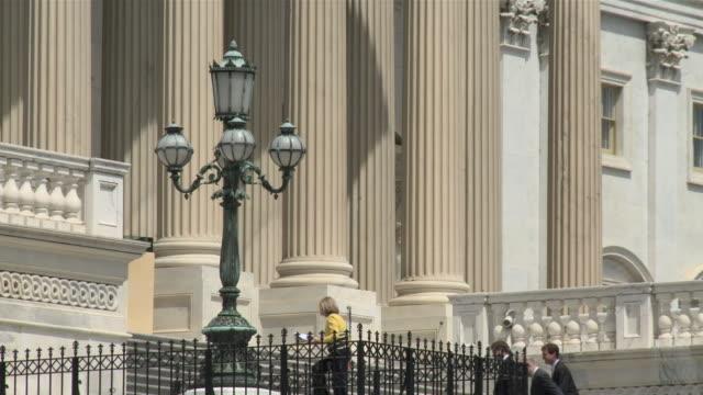 30Jun2010 MS Four people walking up steps of US Capitol / Washington DC United States