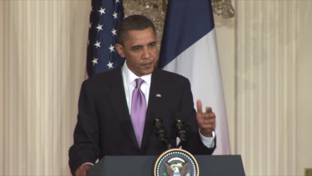 stockvideo's en b-roll-footage met 30mar2010 ms us president barack obama answers reporters questions on iran at press conference during sarkozy's visit / washington dc - 2010