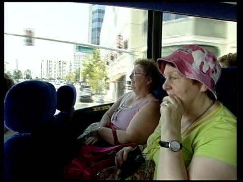 30th anniversary of death of elvis presley; int bus various shots of british tourists on tour bus as it travels through memphis with voiceover of... - irvine video stock e b–roll