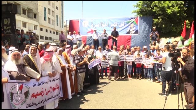 hundreds of palestinian refugees stage a rally on july 31,2018 against recent moves by the un relief and works agency for palestine refugees to scale... - new hire stock videos & royalty-free footage