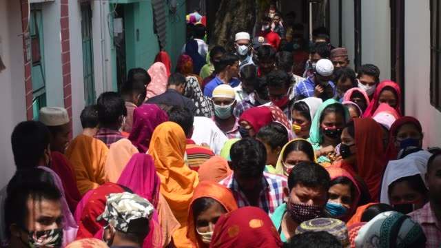31st may 2020: workers of garment factories use a narrow alley to get to work at ashulia on the outskirts of the capital dhaka. as the country... - garment stock videos & royalty-free footage
