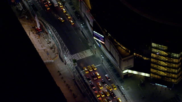 td ws 31st street 8th avenue intersection partial madison square garden building moving edge of circular msg building many yellow taxi cabs 8th... - 34th street stock videos and b-roll footage